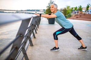 Woman stretching on a jog in Newton, IA