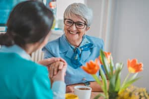 Woman with Alzheimer's smiling in Des Moines, IA